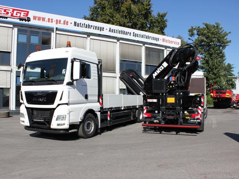 MAN truck loading crane MKG white
